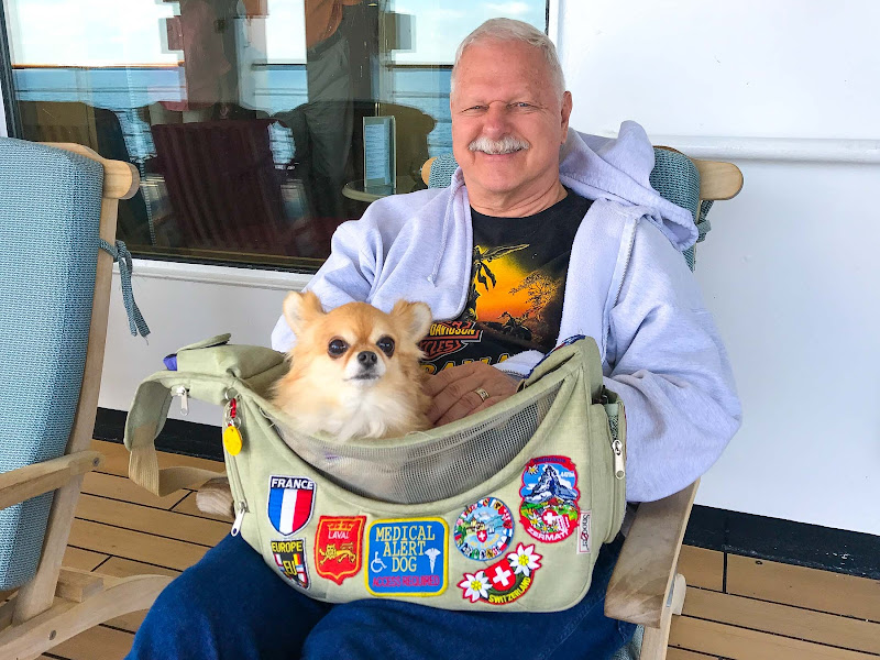 Pete from Las Vegas with his service dog Bijou aboard ms Oosterdam.