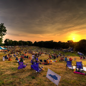 Thunderfest 2012 by Michael  Kitchen - Landscapes Weather ( firecrackers, thunder, glowstick, grass, chairs, chair, sky, thunderfest, sunset, money, tent, trees, fireworks, night, evening )