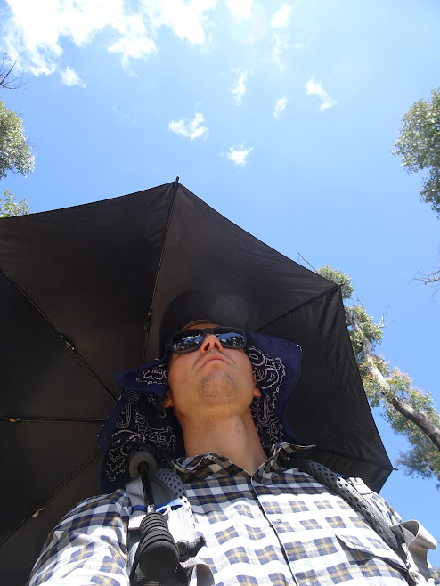 That's how a hiker looks like hidden under his umbrella
