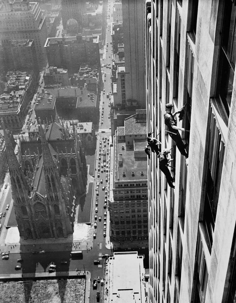 Window cleaners are working on the RCA Building, an American Art Deco skyscraper that forms the centerpiece of Rockefeller Center