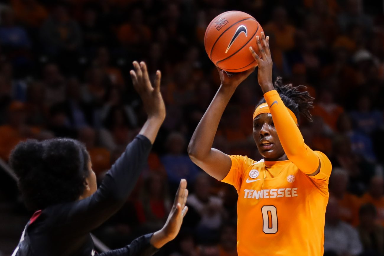 KNOXVILLE, TN - DECEMBER 18: Rennia Davis #0 of the Tennessee Lady Volunteers passes the ball during the game against the Stanford Cardinals at Thompson-Boling Arena on December 18, 2018 in Knoxville, Tennessee. Stanford won the game 95-85. (Photo by Donald Page/Getty Images)