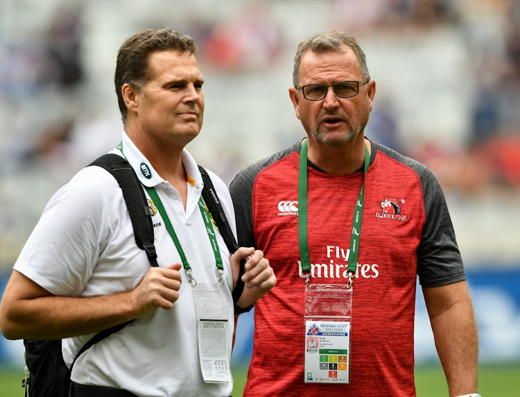 The Springboks head coach and director of rugby Rassie Erasmus (L) and the Emirates Lions head coach Swys de Bruin have a chat during the Super Rugby Super Hero Sunday match between the Lions and the Cell C Sharks at Cape Town Stadium on February 03, 2019.