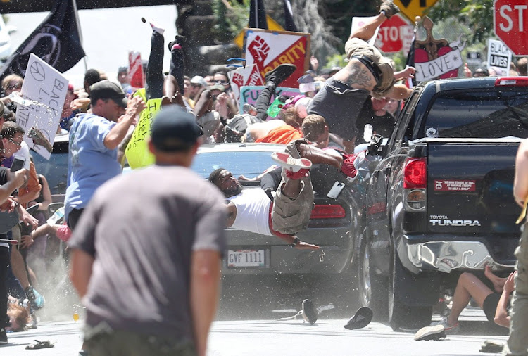 A vehicle plows into a group of protesters marching along 4th Street NE at the Downtown Mall in Charlottesville on the day of the Unite the Right rally on August 12, 2017. The picture won the Pulitzer prize for breaking news photography.
