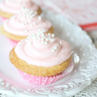 Vanilla Cupcakes With Pink Cream Cheese Frosting.