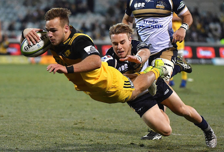 Wes Goosen of the Wellington Hurricanes dives to score a try during the quarterfinal Super Rugby match in Canberra, Australia, on July 21. Picture: REUTERS