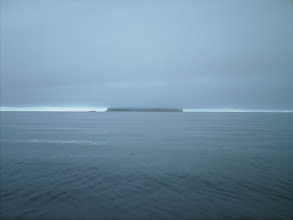 Photo: Sunset Island obscured by fog in Stephens Passage.