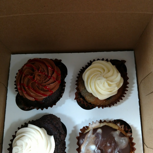 Top left- chocolate strawberry; Top right- Blueberry lemon; Bottom Right- Boston Creme; Bottom Left- chocolate with vanilla frosting