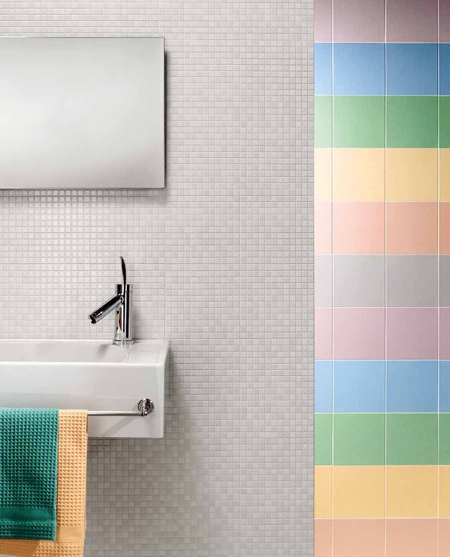 Multiple sizes of square tile on a bathroom wall