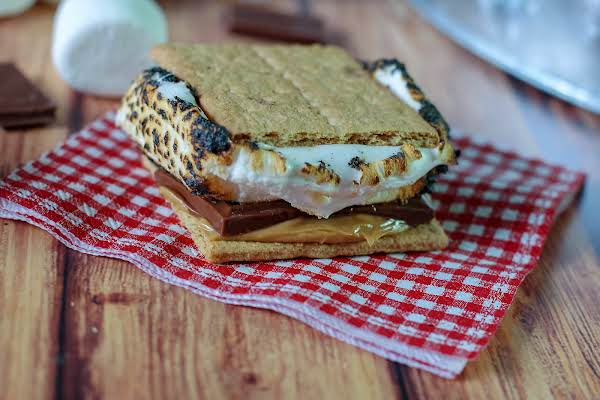 Peanut Butter S'mores On A Gingham Napkin.