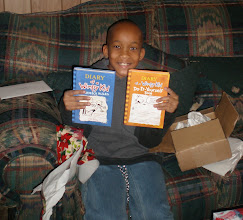 Photo: JIhad w/ two books he received for Christmas