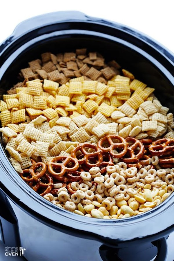 Add cereal, pretzels, cheerios and peanuts to the bowl of a slow cooker.