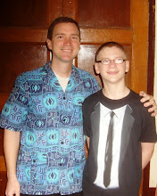 Photo: Father and son - I am wearing a traditional African jacket. Drew is wearing a tux.