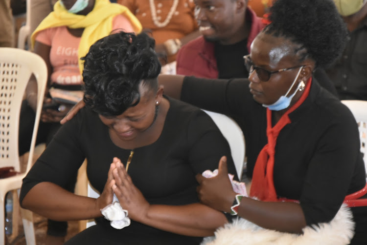 Peter Mbothu's sister Lucy Njokiduring the Requiem Mass in Thika on Friday.