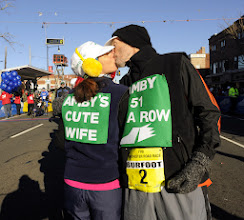 Photo: MANCHESTER 11/28/13  Amby Burfoot gets a kiss from his wife Cristina (cq) as he prepares for his 51 st Manchester Road Race in a row, setting the all time record. (MRR Photo by John Long)