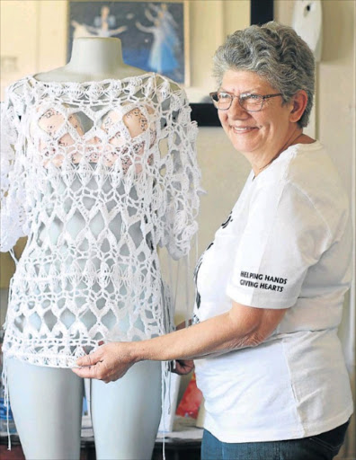 HELPING HANDS: Sonja Schoeman shows off one of her crocheted garments which she sells to fund various outreach projects for the Havencare Centre, as well as for her own weekly feeding scheme Picture: MADELEINE CHAPUT