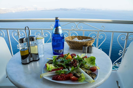 horta-Greek-restaurant-Oia - A plate of horta (greens) at a restaurant overlooking the Aegean Sea in Oia, Santorini.