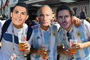 Fans wearing masks of Portugal's forward Cristiano Ronaldo, Russian President Vladimir Putin and Argentina's forward Lionel Messi gather before the Russia 2018 World Cup Group D football match between Argentina and Iceland at the Spartak Stadium in Moscow on June 16, 2018.
