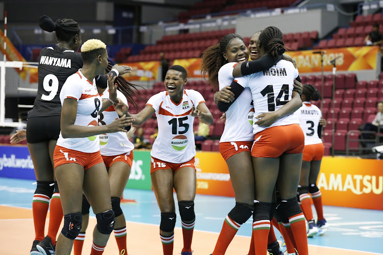 Malkia Strikers' players celebrate during a past match
