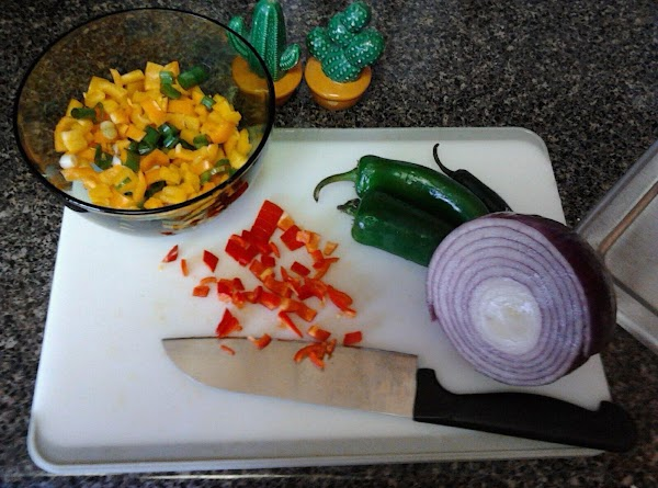 Next, chop and add cilantro, red onion and garlic to mixture.  Stir.