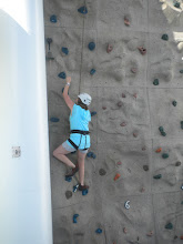Photo: Chandra climing the wall on the boat