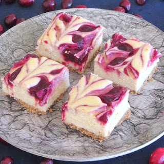 Eggnog Cheesecake Bars with Cranberry Swirl