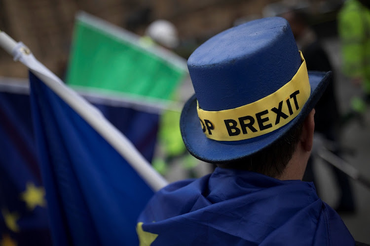 A protester's hat displays the words 'Stop Brexit' as he stands outside the Houses of Parliament in London, Britain, on December 5 2017. Picture: REUTERS