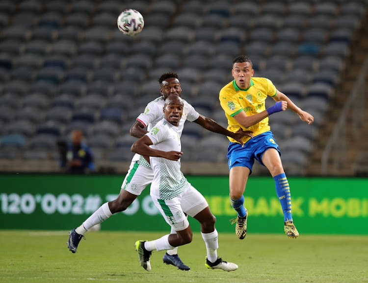 Ricardo Nascimento of Mamelodi Sundowns challenged by Siphelele Luthuli of Bloemfontein Celtic during the Nedbank Cup final match at Orlando Stadium on September 12 2020 in Johannesburg.