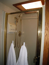 Photo: Full sized shower with skylight.