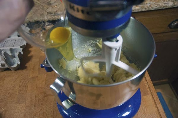 Put the stand mixer on slow speed and add the eggs, one at a...
