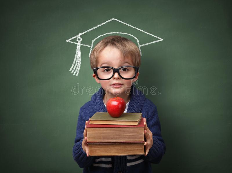 C:\Users\Pohan\Downloads\education-child-holding-stack-books-mortar-board-chalk-drawing-blackboard-concept-university-future-aspirations-41028719.jpg