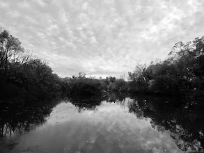 Photo: Black and white photo of interesting clouds reflected in a lake at Eastwood Park in Dayton, Ohio.