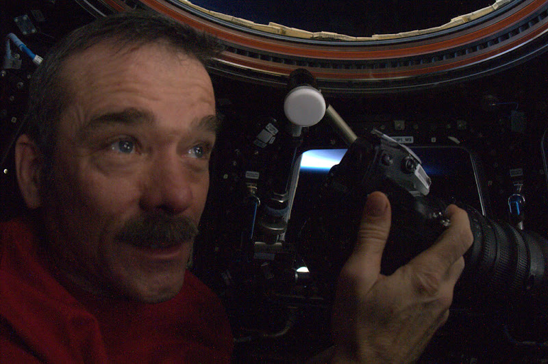 Photo: Taking pictures of our planet from the cupola, a favourite pastime of astronauts aboard the ISS.