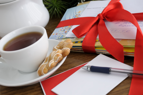 a cup of coffee next to some holiday stationary