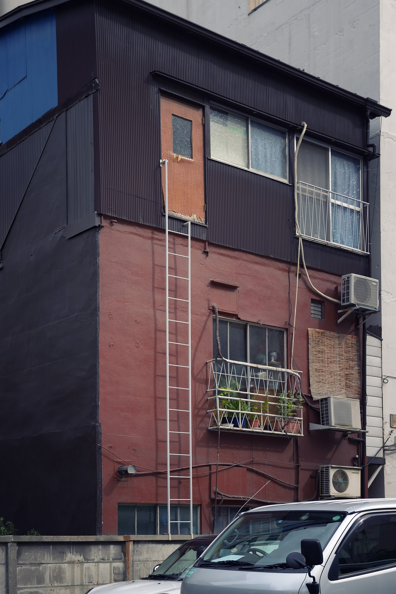 """Photo: Docodemo Door?  I was so curious as to who actually lived here.. do they actually use this door? Or does it serve as the home's """"emergency exit""""? A """"treehouse"""" equivalent in a verdure-challenged city? I think it's more fun to wonder than to actually know the reality. :)  #Tokyo  #Japan"""