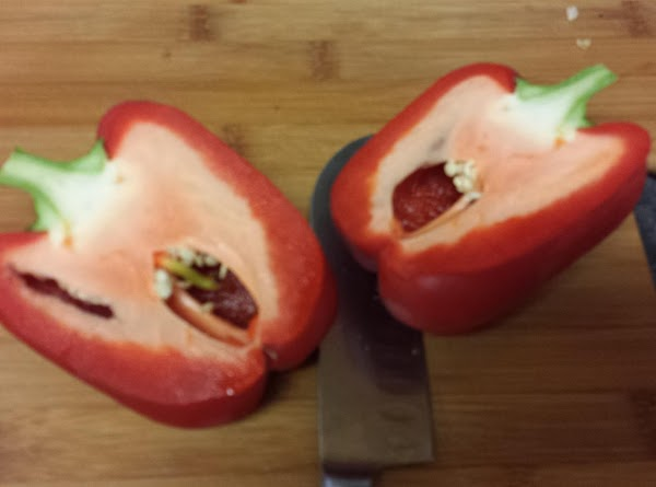 Cut bell peppers into halves lengthwise, leaving part of stem on, and scoop out...