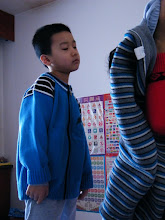 Photo: baby son, warrenzh, 朱楚甲 unease with his new clothes.