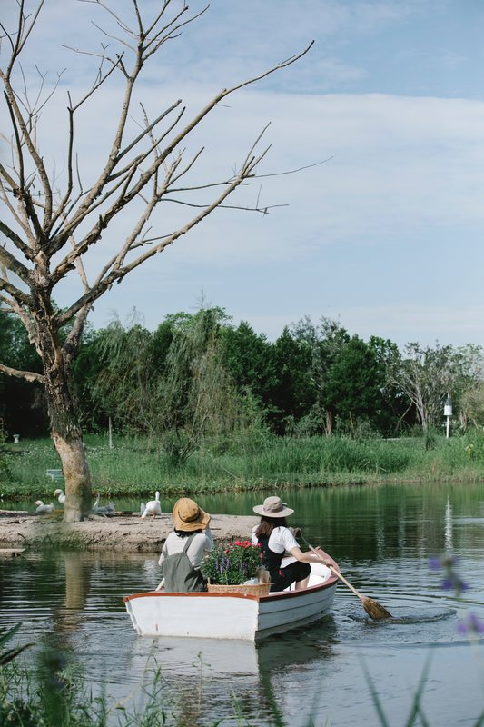 Two women on a boat in a lake