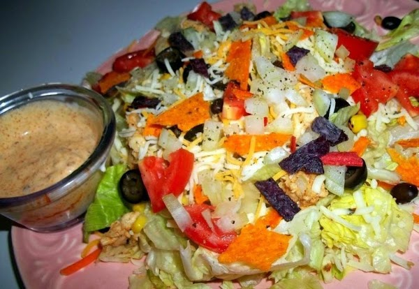 For salad  Plate lettuce, add corn, beans, cheese, onion, tomato, chicken strips, olives and tortilla...