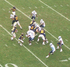 """Photo: Pat White and Noel Devine run the """"zone read"""" option play."""