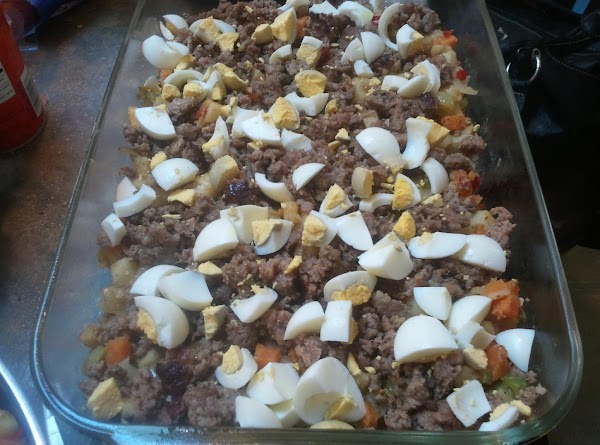 Top with half of cooked sausage, & cubed eggs.