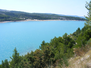 Photo: The striking turquoise blue of the lake (the third largest in France, at a bit over a mile wide, and 8-1/2 miles long) is from its Verdon river source. The lake was formed by a hydroelectric dam (Le Barrage de Saint-Croix) completed in 1975.