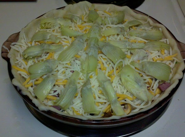 add a layer of cheese, mushrooms, peppers, onion, ham, remaining cheese, then arrange sliced...