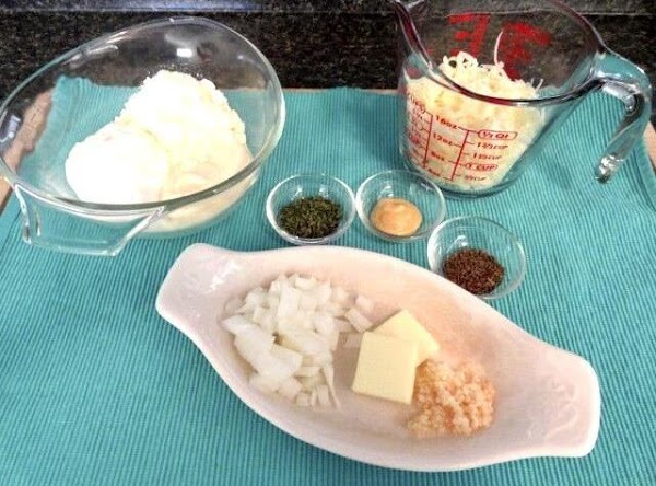 In a mixing bowl add sour cream, mayo, parmesan cheese, dijon mustard, parsley, thyme,...