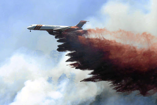 NOT CONTAINED: A plane drops fire-retardant chemicals on the 416 Fire near Durango, Colorado, the US, on June 9 2018. Picture: LA PLATA COUNTY/HANDOUT VIA REUTERS