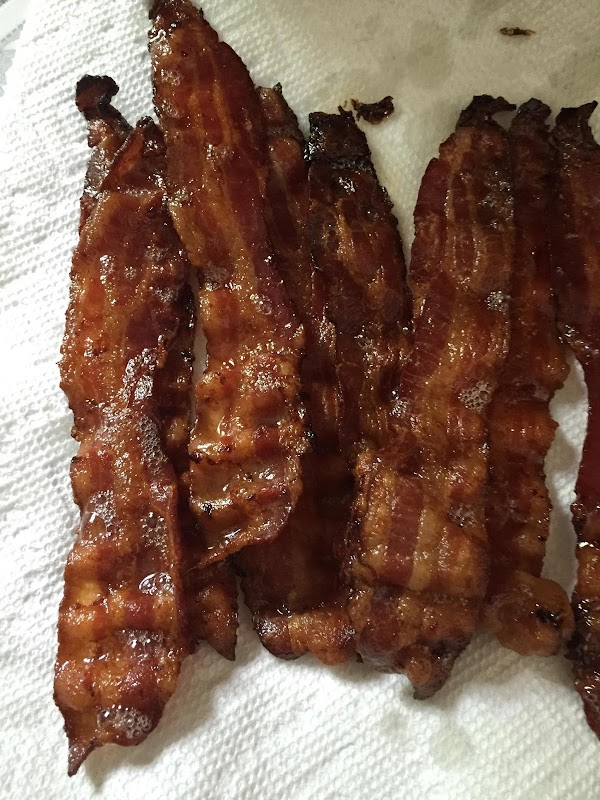Parchment line a baking sheet. Cook bacon in 450° oven until crisp. flip bacon...