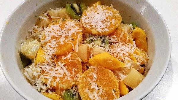In a small bowl, whisk together, pineapple juice, honey, zest and lime juice.  Place prepared...