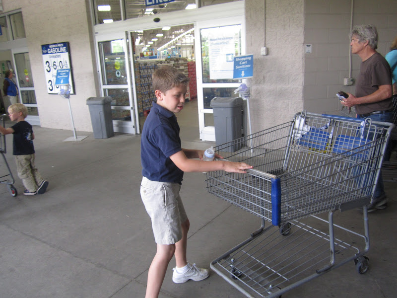 Photo: J-Man likes to help as much as possible so he pushes the buggy.