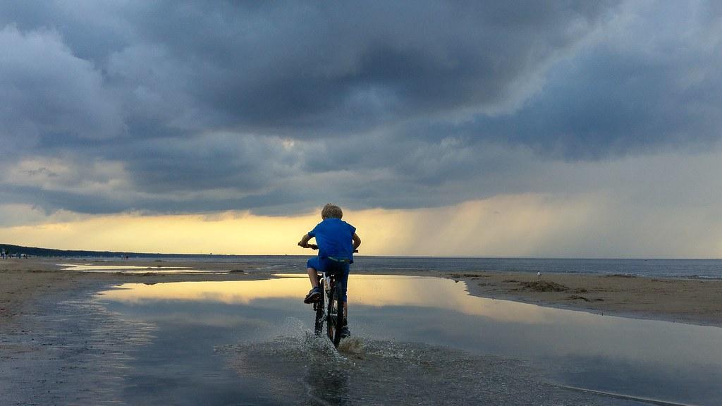 Cruise into a beach sunset on a beach cruiser bike.