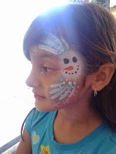 Photo: Holiday face painting by Bella the Clown. Call to book Bella today at 888-750-7024