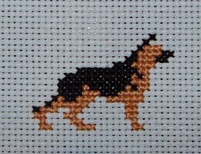 Photo: Completed 17 Apr 2008. German Shepherd Dog, designed by Ann Jackson for the SOTC dog club awards. This was stitched using DMC on a blue aida. Stitch count: 23w x 17h.